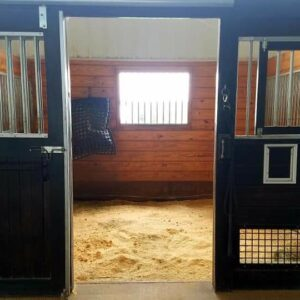 12x12 stalls with sliding doors and stall liners.