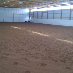 60x120 indoor arena with sliding windows and excellent natural lighting.